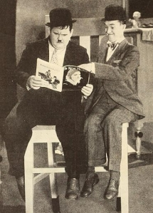 371px-Laurel_&_Hardy_reading_The_New_Movie